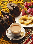 Baked bananas, coffee and wooden African figure