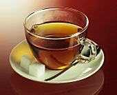A cup of tea with sugar cubes