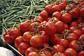 Tomatoes and green beans on a market stall