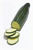A cucumber, partly sliced