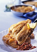 Fried plaice fillets with bacon and fried potatoes