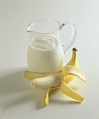Banana kefir drink in glass jug