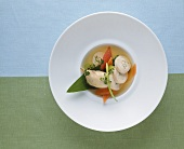 Chicken stew with stuffed chicken roulade and vegetables