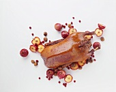 Christmas goose with apples, chestnuts and cranberries
