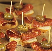 Canapés with chorizo and green olives