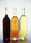 Three bottles of wine: red, rosé and white