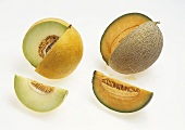 Two melons, each with a wedge removed