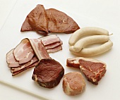 Various types of meat, sausages, bacon and liver