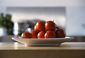 Tomatoes in dish on kitchen table