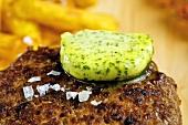 Herb butter melting on burger