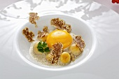 Raw egg with truffle and button mushrooms