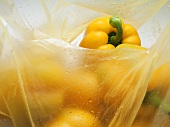 Yellow peppers in a plastic bag