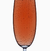 A glass of rosé sparkling wine (detail)