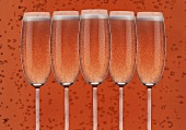 Several glasses of rosé sparkling wine
