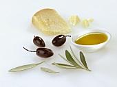 Olive oil, black olives and Parmesan