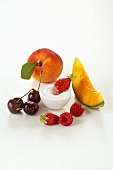 Various types of fruit, berries and sugar