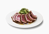Sliced Seared Tuna on a Plate; White Background