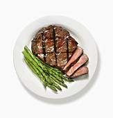 Partially Sliced Grilled Steak with Asparagus; From Above