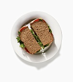 Turkey, Lettuce and Tomato Sandwich on Whole Wheat Bread; From Above