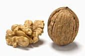 One shelled and one unshelled walnut