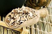 Calamus root (Acorus gramineus) in wooden scoop