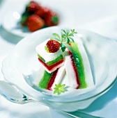 Colourful layered jelly with woodruff