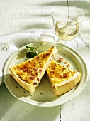 Spicy cheese and caraway seed tart with a glass of white wine