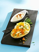 Baked potato with keta caviar and chives