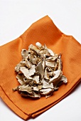 Dried shiitake mushrooms on a paper napkin