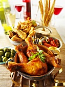 Party buffet with chicken drumsticks