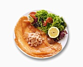 Shrimp salad on smoked salmon, garnished with salad leaves