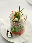 Crab and vegetable salad in a glass