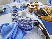 Tea and cakes on laid table