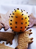 Clove-studded orange and Christmas biscuits