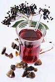 Elderberry tea, elderberries and sugar crystals