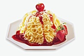 Spaghetti ice cream with strawberries and fruit sauce