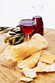 Le lingue di suocera (flatbread), red wine and olives