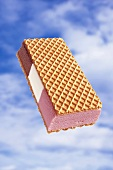 Ice cream wafer against sky