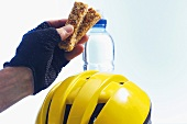 Cyclist holding a muesli bar
