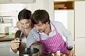 Young couple cooking spaghetti