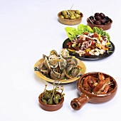 Assorted tapas (capers, seafood and olives)