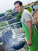 Man grilling on balcony
