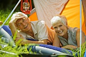 Senior couple relaxing in tent