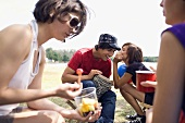 Friends picnicking by lake