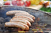 Sausages on barbecue rack