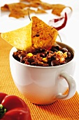 Chili con carne in cup with tortilla chips