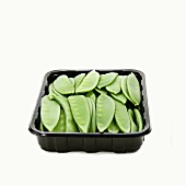 Mangetout in a plastic tray