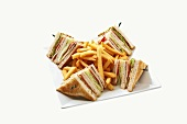Toasted sandwiches (triangles) with chips