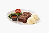 Beefsteak with mashed potato, beans, grilled tomato & sauce