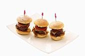 Three mini steak burgers on a plate